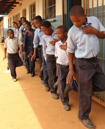 School boys singing about the need to save the Rhinos ...