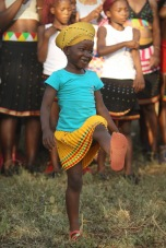 A young Zulu girl performing a traditional dance
